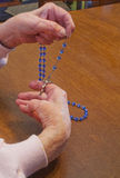 Praying The Rosary Royalty Free Stock Photos