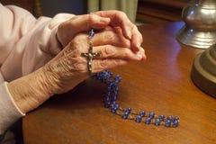 Praying The Rosary Royalty Free Stock Photo