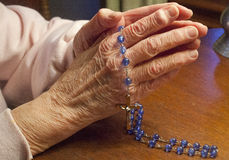 Praying The Rosary Stock Photos