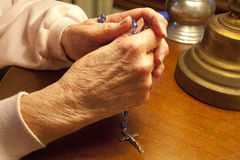 Praying The Rosary Stock Image