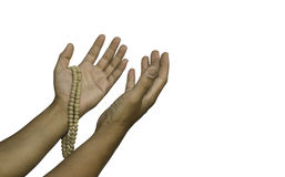 Praying the rosary in the hands of men on a white background. Royalty Free Stock Images