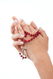 Praying with rosary, isolated Royalty Free Stock Photo