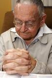 Praying senior citizen Royalty Free Stock Photos