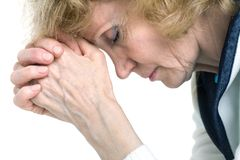 Praying senior woman. Portrait of an elderly woman in  praying process Stock Photo