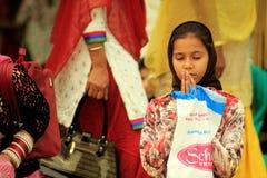 Praying Sikh girl. Amritsar, Punjab, India. March 01, 2014: Praying Sikh girl in front of Golden Temple in Amritsar Stock Image