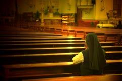 Praying sister Stock Photo