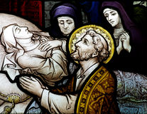 Praying for the soul of a dead lady (stained glass) Royalty Free Stock Photography
