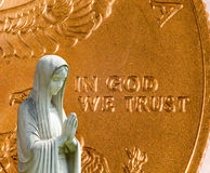 Praying statue with cash background Royalty Free Stock Photography