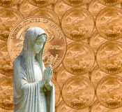 Praying statue with cash background Royalty Free Stock Images