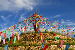 Praying stone and prayer flags on steppe Royalty Free Stock Photo