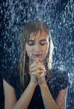 Praying in the storm Stock Image
