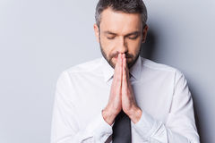 Praying for success. Stock Photo