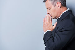 Praying for success. Stock Photos
