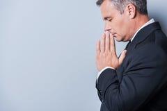 Praying for success. Stock Photos