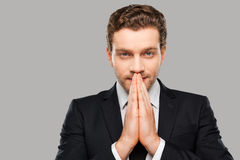 Praying for success. Stock Images