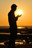 Praying at sunset Royalty Free Stock Images