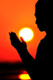 Praying at sunset Royalty Free Stock Photo