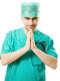 Praying the surgeon Royalty Free Stock Image