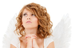 Praying teenage angel girl Royalty Free Stock Images