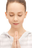 Praying teenage girl Royalty Free Stock Image