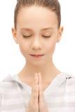 Praying teenage girl Royalty Free Stock Image
