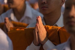 Praying for their first ordination. Thai male have to wear white dress and purify their minds before entering the ordination ceremony Stock Photo
