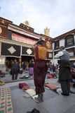 Praying tibetan. At the entrance of Jokhang Temple. Everyday pilgrims from every corner of Tibet trek a long distance to the temple. they always hold prayer Royalty Free Stock Photos
