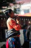 Praying Tibetant Woman Royalty Free Stock Photo