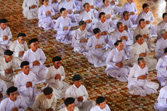 Praying time, men and women worshipping at Cao Dai Royalty Free Stock Images
