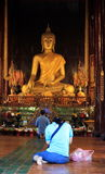 Praying to Buddha Stock Photos
