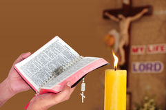 Praying to God jesus. Christian believer praying to God with rosary and bible in hand Stock Photos