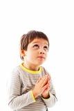 Praying to God. Little boy praying to God, looking up Stock Photos