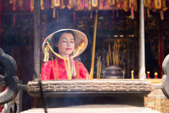 Praying Vietnamese woman Stock Photo