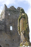 Praying Virgin Mary Statue with castle behind, Rock of Cashel Royalty Free Stock Photo