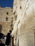 Praying at the wall. An Orthodox Jew the western wall of the temple mount Stock Photo
