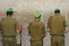 Praying at the Western Wall. Israeli soldiers praying at the Western Wall in Jerusalem Israel Royalty Free Stock Images