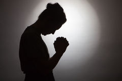 Praying woman royalty free stock photo