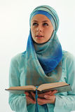 Praying woman. Young woman with Koran praying Stock Photo