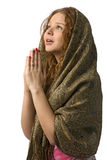 Praying woman. Young woman with hands in praying, isolated on white royalty free stock images