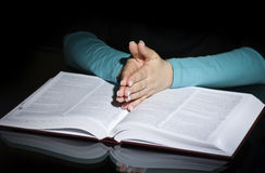 Praying woman and bible Royalty Free Stock Images