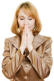 Praying woman in business suit with gold Royalty Free Stock Photo