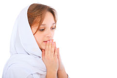 Praying  woman close-up portrait. Isolated on white background Stock Photography