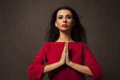 Praying woman with folded hands Stock Photos