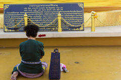 Praying woman in front of Wat Saket in Bangkok Royalty Free Stock Images