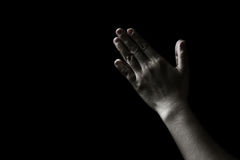 Praying woman hand in the dark  praying in secret room concept Stock Image