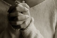 Praying woman hands Stock Images