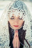 Praying woman in Lacy tippet in winter. Fairy tale girl in a winter landscape. Christmas. Royalty Free Stock Photography