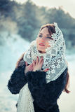 Praying woman in Lacy tippet in winter. Fairy tale girl in a winter landscape. Christmas. Stock Images