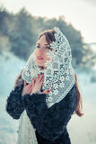 Praying woman in Lacy tippet in winter. Fairy tale girl in a winter landscape. Christmas. Royalty Free Stock Image