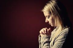 Praying woman. stock images